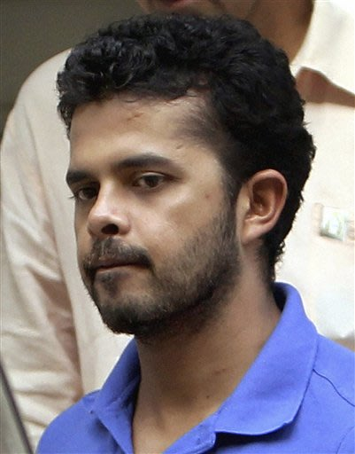 Indian cricket player Shantakumaran Sreesanth walks to be produced in court in New Delhi, India, Tuesday, May 21, 2013. India's top court asked the Board of Control for Cricket in India to wrap up in