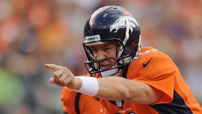 Denver Broncos quarterback Peyton Manning (18) calls an audible against the St. Louis Rams in the second quarter of a preseason NFL football game, Saturday, Aug. 24, 2013, in Denver. (AP Photo/Jack Dempsey)