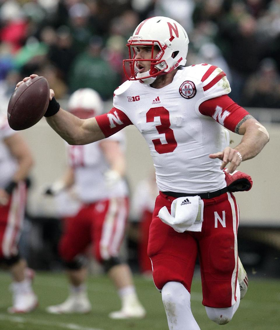 Nebraska quarterback Taylor Martinez scrambles during the second quarter of an NCAA college football game against Michigan State, Saturday, Nov. 3, 2012, in East Lansing, Mich. (AP Photo/Al Goldis)