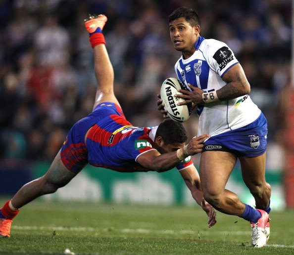 Ben Barba of the Bulldogs breaks clear of Dane Gagai of the Knights during the round 22 NRL match between Canterbury-Bankstown Bulldogs and Newcastle Knights at Hunter Stadium on August 4, 2012 in New