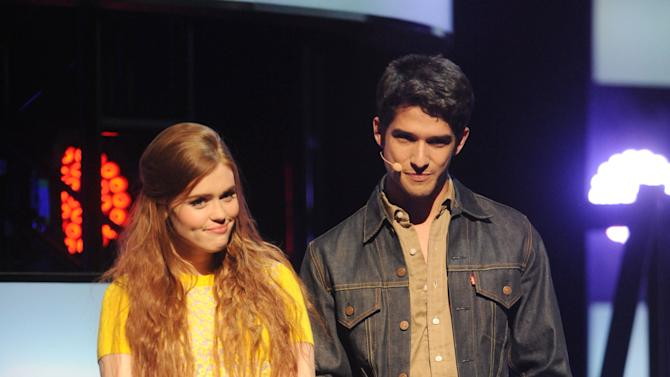 """IMAGE DISTRIBUTED FOR MTV - From left, Holland Roden and Tyler Posey introduce """"Teen Wolf"""" at the 2013 MTV Upfront, on Thursday, April 25, 2013 at the Beacon Theater in New York. (Photo by Brad Barket/Invision for MTV/AP Images)"""