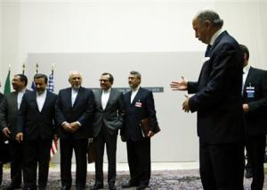 French Foreign Minister Fabius gestures as Iranian…