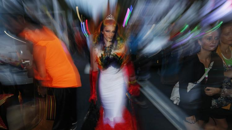 A drag queen is pictured in the crowd before the 2014 Sydney Gay and Lesbian Mardi Gras parade