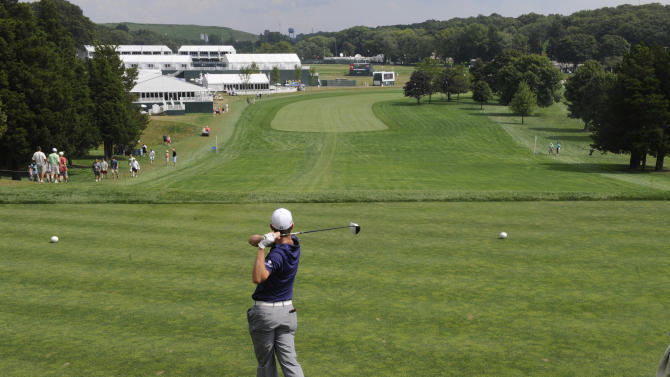 Justin Rose of England tees off on the first hole during the Pro-Am for The Barclays golf tournament at Bethpage State Park in Farmingdale, N.Y., Wednesday, Aug. 22, 2012. (AP Photos/Henny Ray Abrams)