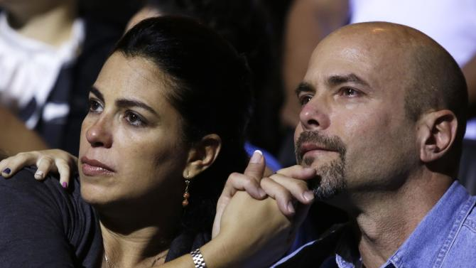 """Gerardo Hernandez , one of so-called """"Cuban Five"""", and his wife Adriana Perez (L) attend a concert of the Cuban musician Silvio Rodriguez in Havana"""