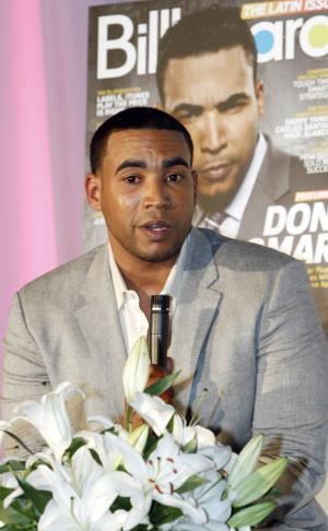 Puerto Rican reggaeton singer-rapper Don Omar talks to a reporter in Miami, Tuesday, April 24, 2012. Don Omar is the is the leading finalist in the 2012 Billboard Latin Music Awards. (AP Photo/Alan Diaz)