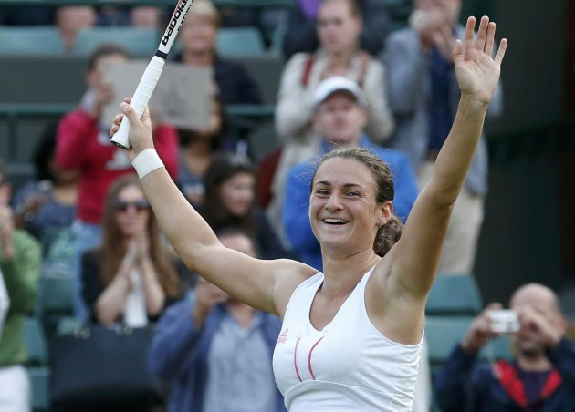 Vesna Dolonc of Serbia celebrates after defeating Jelena Jankovic of Serbia in their women's singles tennis match at the Wimbledon Tennis Championships, in London