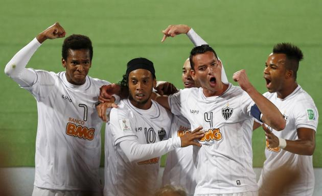 Atletico Mineiro's Ronaldinho celebrates with his team mates his goal against Raja Casablanca during their FIFA Club World Cup semi-final soccer match at Marrakech stadium