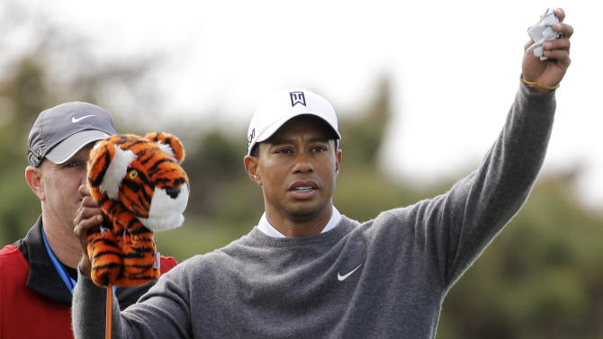 Tiger Woods pulls his driver from the bag  as he gets ready for his tee shot on the fourth hole at Torrey Pines during the third round of the Farmers Insurance Open golf tournament, Sunday, Jan. 27, 2013, in San Diego. (AP Photo/Lenny Ignelzi)