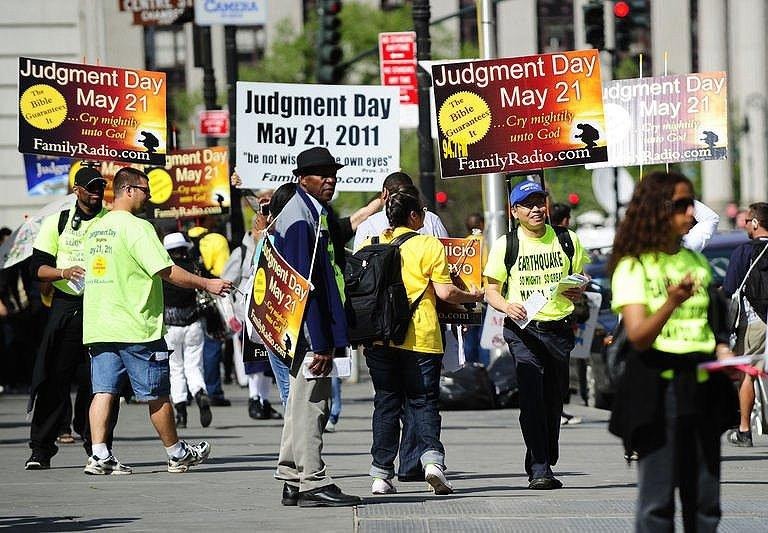 "Activists believing that ""Judgement Day"" will happen on May 21, spread their word near Manhattan City hall in New York on May 12. With an aging fundamentalist Christian preacher warning that Saturday is Judgment Day, some Americans have been getting ready"