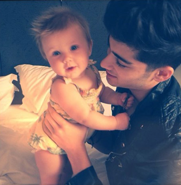 Harry Styles and Zayn Malik posed with their stylist's little baby Lux