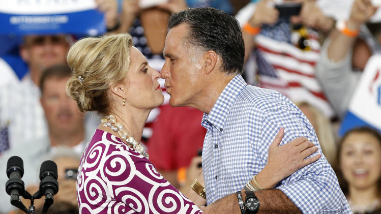 Republican presidential candidate and former Massachusetts Gov. Mitt Romney, right, kisses his wife Ann during a campaign rally, Sunday, Oct. 7, 2012, in Port St. Lucie, Fla. (AP Photo/Lynne Sladky)