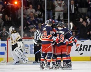 Rangers snap 2 ties in 3rd, top Bruins 4-3