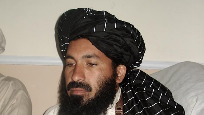 In this April, 20, 2007 file photo, Pakistani militant commander Maulvi Nazir meets his associates in South Waziristan, Pakistan near the Afghani border. Five Pakistani security officials said the commander, Nazir, was reportedly among nine people killed in a missile strike on a house in the village of Angoor Adda in the South Waziristan tribal region early Thursday. The officials spoke on condition of anonymity because they were not authorized to brief the media. (AP Photo/Ishtiaq Mahsud)