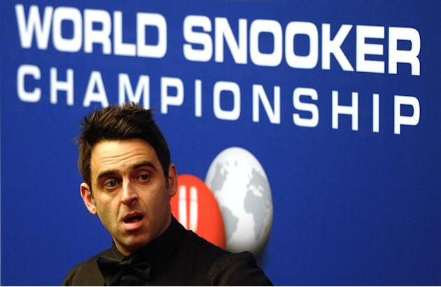 Ronnie O'Sullivan of England prepares to play a shot during a first round match of the World Championship Snooker tournament against Peter Ebdon of England at the Crucible Theatre in Sheffield, north-