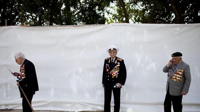 World War II veterans attend a ceremony marking the annual Holocaust Remembrance Day at the Yad Vashem Holocaust Memorial in Jerusalem, Monday, April 8, 2013. Israel came to a standstill for two mournful minutes Monday as sirens pierced the air in an annual ritual to remember the 6 million Jews systematically murdered by German Nazis and their collaborators during the Holocaust in World War II. (AP Photo/Oded Balilty)