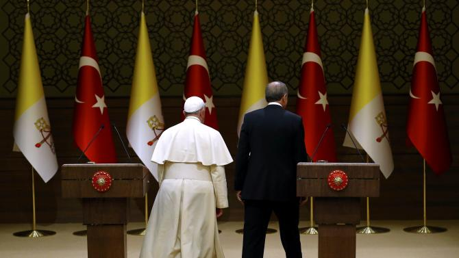 Pope Francis and Turkey's President Erdogan leave after addressing to media at the presidential palace in Ankara