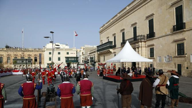 Britain's Prince William and Maltese Prime Minister Muscat watch a re-enactment of a 16th century military parade outside the Presidential Palace in Valletta