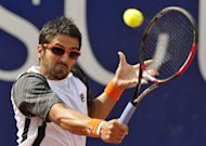Serbia's Janko Tipsarevic returns the ball to Germany's Bjorn Phau during their quarterfinal match at the ATP tennis tournament in Stuttgart, southwestern Germany. Tipsarevic 6-7 (6/8), 7-6 (7/2), 6-4