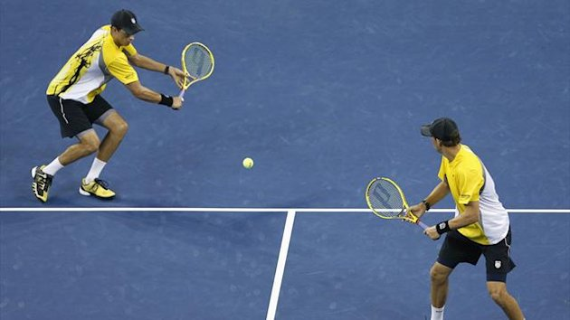 Bob Bryan (L) of the US prepares to hit a return next to brother Mike during their men's doubles match (Reuters)