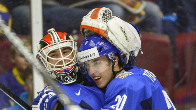 Finland's Teravainen hugs goalie Saros after their team won against Czech Republic in the World Junior Hockey Championships quarter final match at the Malmo Arena in Malmo