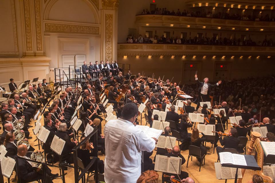 "In this May 24, 2012, provided by Carnegie Hall, Eric Owens, center, sings the role of Jochanaan, the Prophet, during a performance of  Strauss's ""Salome"" with the Cleveland Orchestra, led by Franz Welser-Moest at Carnegie Hall in New York. (AP Photo/Carnegie Hall, Chris Lee)"
