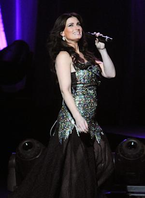 """FILE - This June 16, 2014 file photo shows Idina Menzel performing at Radio City Music Hall in New York. Menzel will sing the national anthem at the MLB All-Star Game on July 15 in Minneapolis, Minn. She will also perform during its pre-game ceremony, including a cover of Bob Dylan's """"Forever Young."""" (Photo by Brad Barket/Invision/AP, File)"""
