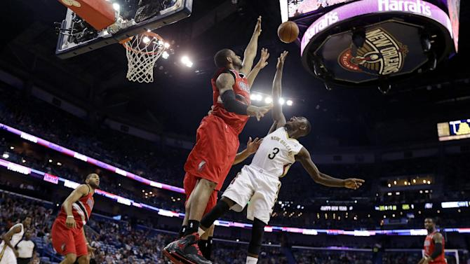 Evans, Holiday lead Pelicans past Blazers 110-108