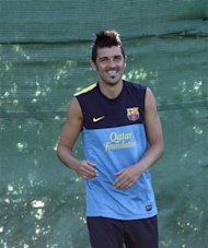 Barcelona's player David Villa smiles during the training session at Joan Gamper training camp, near Barcelona, July 19, 2012. REUTERS/Gustau Nacarino
