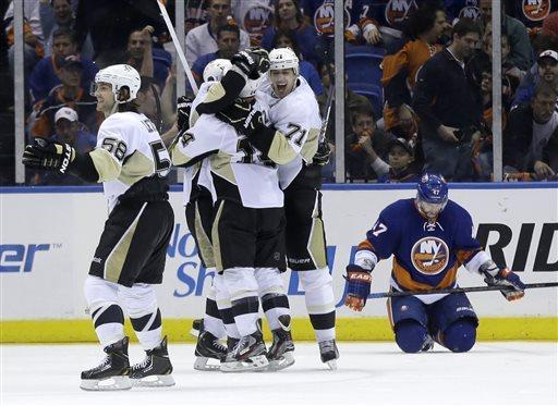 Kunitz's 2nd PP goal gives Pens OT win over Isles