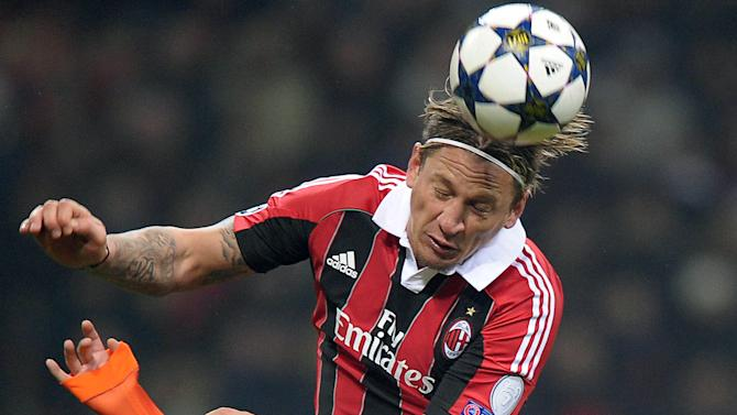 AC Milan defender Philippe Mexes jumps higher than Barcelona's Pedro during their Champions League round of 16, first leg soccer match, at the San Siro stadium in Milan, Italy, Wednesday, Feb. 20, 2013. AC Milan won 2-0. (AP Photo/Fabio Ferrari, Lapresse)