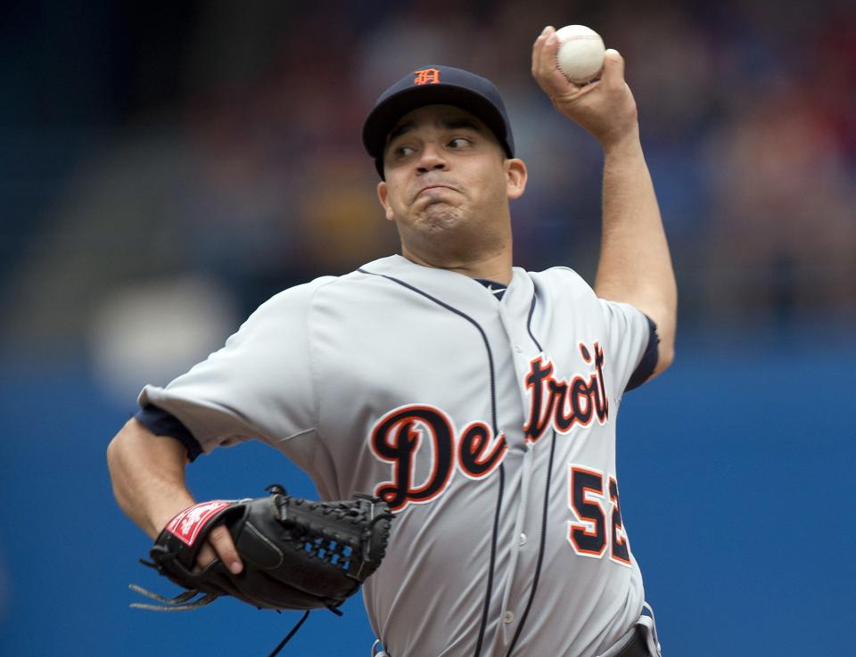 Detroit Tigers starting pitcher Jose Alvarez pitches during first inning of a baseball game against the Detroit Tigers in Toronto, Monday, July 1, 2013. (AP Photo/The Canadian Press, Frank Gunn)