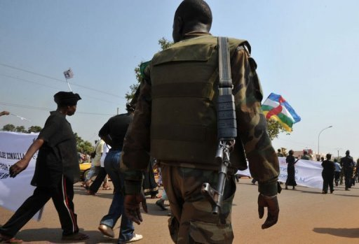 <p>A soldier ensures security during a women's march in Bangui against the conflict in the Central African Republic on December 28, 2012. The Central African Republic's neighbours took steps Friday to tackle the crisis in the chronically unstable nation, where rebels have advanced towards the capital Bangui, stoking local and international alarm.</p>