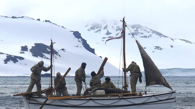 """In this Jan. 23, 2013 photo released by Shackleton Epic, adventurers aboard their boat Alexander Shackleton leave Elephant Island. A modern-day team of six led by Tim Jarvis and Barry """"Baz"""" Gray used similar equipment and clothes to re-enact a 1916 expedition led by Ernest Shackleton to save his crew after their ship got stuck in Antarctica's icy waters. They reached an old whaling station on remote South Georgia island Monday, Feb. 11, 2013, 19 days after leaving Elephant Island. Just as Shackleton did in 1916, Jarvis and his team sailed 800 nautical miles across the Southern Ocean in a small lifeboat and then climbed over crevasse-filled mountains in South Georgia. (AP Photo/Shackleton Epic, Jo Stewart)"""