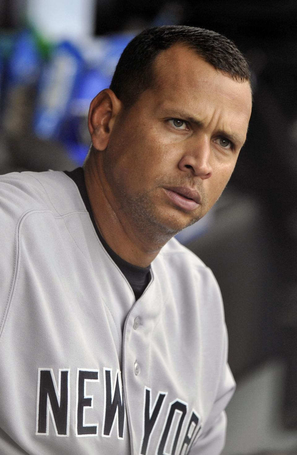 New York Yankees' Alex Rodriguez looks on from the dugout during the first inning of a baseball game against the Chicago White Sox in Chicago, Monday, Aug. 5, 2013. (AP Photo/Paul Beaty)