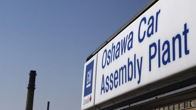 FILE-In this Monday, Sept. 17, 2012, file photo, a sign stands outside Oshawa's General Motors car assembly plant in Oshawa, Ontarrio . General Motors, said Tuesday, Oct. 2, 2012,  its U.S. sales rose 1.5 percent in September, as a big jump in car sales was offset by falling truck sales. The company says new models boosted car sales by 29 percent. But sales of the Chevrolet Silverado, GM's top-selling vehicle, fell almost 17 percent from a year ago.  (AP Photo/The Canadian Press, Michelle Siu)