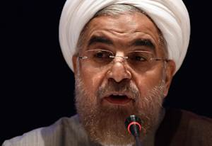 Iranian President Hassan Rouhani answers a question…