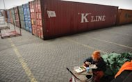 Workers have lunch at the port of Yangshan in Shanghai. China's trade surplus widened in April, the customs agency said, as weak imports growth dulled the negative impact of poor exports caused by stagnation in Europe