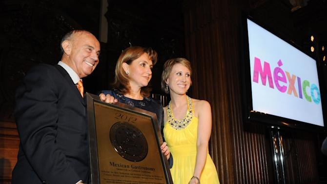 COMMERCIAL IMAGE - In this photograph taken by AP Images for Mexico Tourism Board, Mexico Secretary of Tourism Gloria Guevara, center, receives the Star Diamond Award for Mexican gastronomy from Joseph Cinque, left, president of the Academy of Hospitality Sciences, and Karen Lynn Dixon, international general manager of the Academy, on Thursday, April 26, 2012 in New York.  (Jonathan Fickies/AP Images for Mexico Tourism Board)