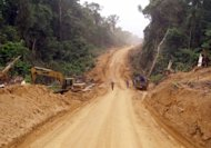 Heavy earthmoving equipment works in 2010 on a 75km strategic dirt road built by the Cameroon army near Akwa on the Cameroon-Nigerian boarder. Cameroon and China signed a large infrastructure deal Thursday that will see Beijing lend the African country 368 million euros to build its first new motorway since independence in 1960