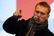 Anti-Kremlin blogger Alexei Navalny speaks during a rally against December 4 parliamentary elections in Moscow. Russian investigators on Tuesday charged popular protest leader Navalny with embezzlement in an old case that may put one of President Vladimir Putin's most vocal critics in jail for 10 years. (AFP Photo/Kirill Kudryavtsev)