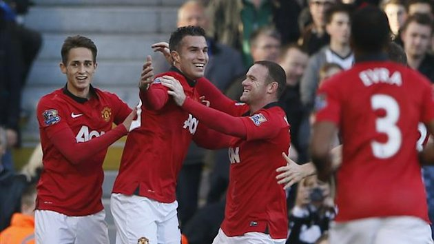 Manchester United's Robin Van Persie (L) celebrates with team-mate Wayne Rooney (R) after scoring a goal against Fulham during their English Premier League soccer match at Craven Cottage in London November 2, 2013. (Reuters)