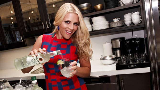 COMMERCIAL IMAGE - In this photograph taken by AP Images for BACARDI, actress Busy Philipps pours herself a BACARDI Classic Cocktails Light Mojito at the BACARDI launch event at Robert Verdi's Luxe Laboratory on May 24, 2012 in New York. (Brian Ach /AP Images for BACARDI)