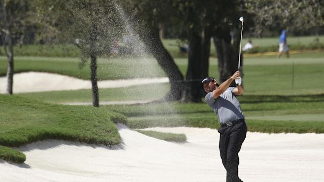 Jason Day, of Australia, hits onto the 11th green during the second round of the Cadillac Championship golf tournament in Doral, Fla., Friday, March 6, 2015. (AP Photo/J Pat Carter)