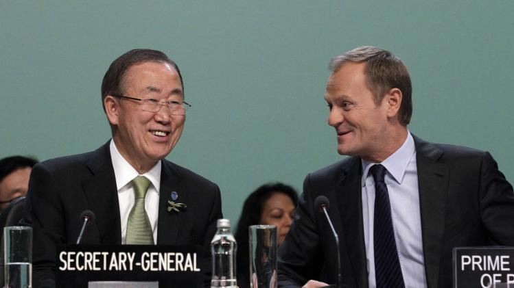 File photo shows Poland's PM Tusk and U.N. Secretary General Ban at the Convention on Climate Change COP19 conference in Warsaw