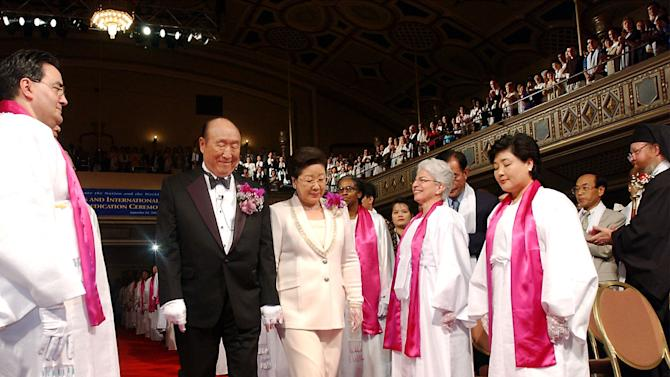 FILE - In this Saturday, Sept. 14, 2002 photo, Rev. Sun Myung Moon, center left, and his wife Hak Ja Han Moon walk down a red carpet as they are introduced during the Affirmation of Vows part of the Interreligious and International Couple's Blessing and Rededication Ceremony at New York's Manhattan Center. About 500-600 couples participated in the New York ceremony and an estimated 21 million couples participated worldwide via a simulcast to 185 countries. Rev. Moon, self-proclaimed messiah who founded the Unification Church, has died at age 92 church officials said Monday, Sept. 3, 2012. (AP Photo/Stephen Chernin)