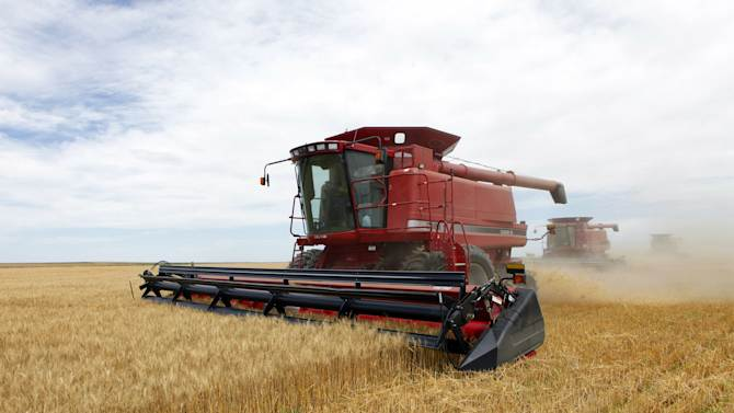 FILE - In this July 9, 2009 file photo three combines harvest the winter wheat on the Cooksey farm near Roggen, Colo.This week the Senate resumes debate on the almost $100 billion-a-year, massive, five-year farm bill that would set policy for farm subsidies and food stamps. The bill also covers everything from protecting environmentally sensitive land to international food aid to rural communications services. The House is expected to consider their version in June or July. (AP Photo/Ed Andrieski, File)