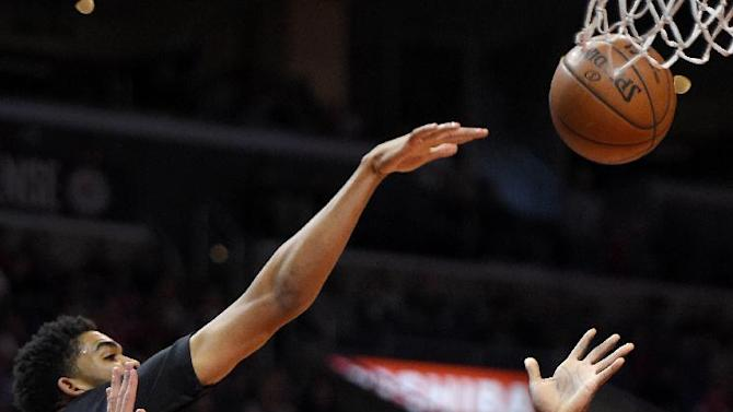 Los Angeles Clippers forward Lance Stephenson (1) shoots as Minnesota Timberwolves guard Andrew Wiggins, top left, defends during the first half of an NBA basketball game, Sunday, Nov. 29, 2015, in Los Angeles. (AP Photo/Mark J. Terrill)