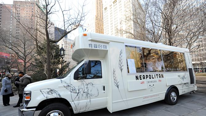IMAGE DISTRIBUTED FOR NEAPOLITAN EXPRESS - Neapolitan Express, the first mobile food truck fully-powered by compressed natural gas, is unveiled at City Hall Park in New York, Thursday, Feb. 21, 2013. (Diane Bondareff/Invision for Neapolitan Express/AP Images)
