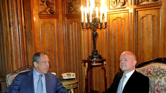 Russian Foreign Minister Sergey Lavrov, left, speaks to his British counterpart William Hague during their meeting in Moscow, Russia, Monday, May 28, 2012, which is expected to focus on the Syria crisis. (AP Photo/Pool)